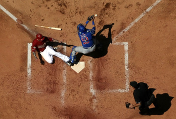 PHOENIX, AZ - MAY 01:  Ryan Roberts #14 of the Arizona Diamondbacks safely slides in to score a run past catcher Geovany Soto #18 of the Chicago Cubs during the fourth inning of the Major League Baseball game at Chase Field on May 1, 2011 in Phoenix, Ariz