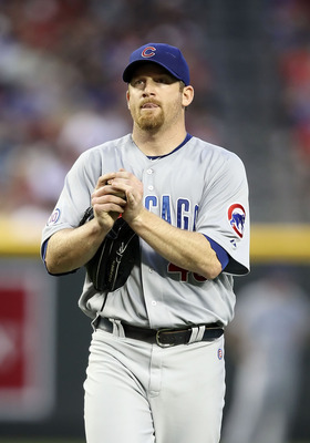 PHOENIX, AZ - APRIL 28:  Starting pitcher Ryan Dempster #46 of the Chicago Cubs reacts on the mound during the first inning of the Major League Baseball game at Chase Field on April 28, 2011 in Phoenix, Arizona.  (Photo by Christian Petersen/Getty Images)