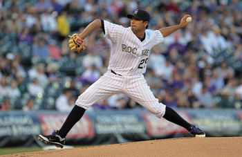 DENVER, CO - APRIL 02:  Starting pitcher Jorge De La Rosa #29 of the Colorado Rockies delivers against the Arizona Diamondbacks at Coors Field on April 2, 2011 in Denver, Colorado.  (Photo by Doug Pensinger/Getty Images)