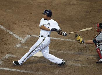 MILWAUKEE, WI - APRIL 04: Carlos Gomez #27 of the Milwaukee Brewers hits the ball against the Atlanta Braves during the home opener at Miller Park on April 4, 2011 in Milwaukee, Wisconsin. The Braves defeated the Brewers 2-1. (Photo by Jonathan Daniel/Get