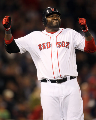 BOSTON, MA - APRIL 30: David Ortiz #34 of the Boston Red Sox reacts after hit a fly out against the Seattle Mariners on April 30, 2011 at Fenway Park in Boston, Massachusetts.  (Photo by Elsa/Getty Images)