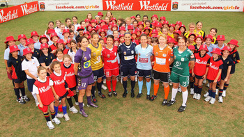 SYDNEY, AUSTRALIA - NOVEMBER 01:  Kathryn Gill, Thea Slatyer, Victoria Balomenos, Melissa Barbieri, Kyah Simon, Clare Polkinghorne and Sally Shipard pose with school children during the W-League Season Launch at the University of NSW Campus on November 1,