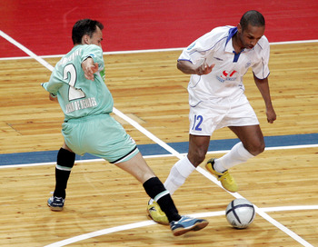 MOSCOW - MAY 7: Pele (R) of Dinamo Moscow competes against Markinio of Boomerang Interviu FS  during UEFA Futsal Cup final on May 7, 2006 in Moscow, Russia.  (Photo by Dmitry Korotaev/Pressphotos/Getty Images)