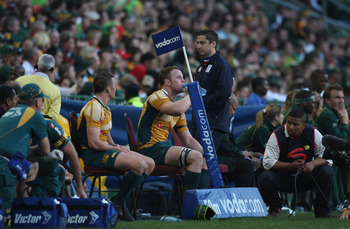 CAPE TOWN, SOUTH AFRICA - AUGUST 08:  Matt Giteau (L) and Richard Brown of the Wallabies sit on the sin bin bench during the Tri Nations match between the South Africa Springboks and the Australia Wallabies at Newlands Stadium on August 8, 2009 in Cape To