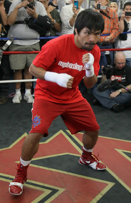 HOLLYWOOD, CA - APRIL 20:  Manny Pacquiao of the Philippines trains inside the ring during a media workout at the Wild Card Boxing Club on April 20, 2011 in Hollywood, California.  (Photo by Jeff Gross/Getty Images)