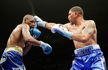 LAS VEGAS - APRIL 11:  Winky Wright (R) hits Paul Williams in the sixth round of their middleweight bout at the Mandalay Bay Events Center April 11, 2009 in Las Vegas, Nevada. Williams won by unanimous decision.  (Photo by Ethan Miller/Getty Images)