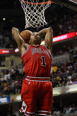INDIANAPOLIS, IN - APRIL 23: Derrick Rose #1 of the Chicago Bulls goes uo for a dunk against the Indiana Pacers in Game Four of the Eastern Conference Quarterfinals in the 2011 NBA Playoffs at Conseco Fieldhouse on April 23, 2011 in Indianapolis, Indiana.