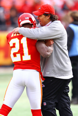 KANSAS CITY, MO - JANUARY 09:  Head coach Todd Haley of the Kansas City Chiefs hugs cornerback Javier Arenas #21 prior to the 2011 AFC wild card playoff game against the Baltimore Ravens at Arrowhead Stadium on January 9, 2011 in Kansas City, Missouri.  (