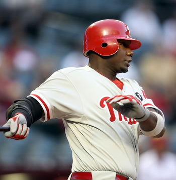 PHOENIX, AZ - APRIL 26:  Ryan Howard #6 of the Philadelphia Phillies hits a double against the Arizona Diamondbacks during the first inning of the Major League Baseball game at Chase Field on April 26, 2011 in Phoenix, Arizona.  (Photo by Christian Peters