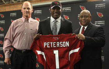 TEMPE, AZ - APRIL 29:  (L-R) Head coach Ken Whisenhunt, first round draft pick Patrick Peterson and general manager Rod Graves of the Arizona Cardinals pose together during a press conference to introduce Peterson at the team's training center auditorium