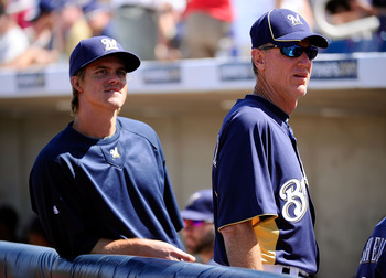 PHOENIX, AZ - MARCH 10:  Pitcher Zack Greinke #13  of the Milwaukee Brewrers stands near manager Ron Roenicke during the spring training baseball game against Colorado Rockies at Maryvale Baseball Park on March 10, 2011 in Phoenix, Arizona.  (Photo by Kev