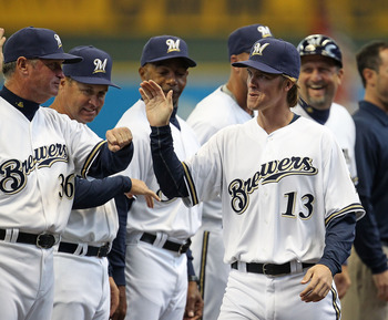 MILWAUKEE, WI - APRIL 04: Zack Greinke #13 of the Milwaukee Brewers greets coaches during player inrtoductions before the home opener against the Atlanta Braves at Miller Park on April 4, 2011 in Milwaukee, Wisconsin. The Braves defeated the Brewers 2-1.