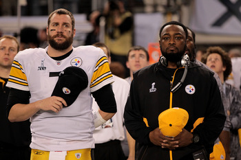 ARLINGTON, TX - FEBRUARY 06:  Ben Roethlisberger #7 and head coach Mike Tomlin of the Pittsburgh Steelers look on during the National Anthem during Super Bowl XLV at Cowboys Stadium on February 6, 2011 in Arlington, Texas.  (Photo by Jamie Squire/Getty Im