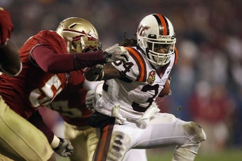 CHARLOTTE, NC - DECEMBER 04:  Ryan Williams #34 of the Virginia Tech Hokies runs with the ball against the Florida State Seminoles during their game at Bank of America Stadium on December 4, 2010 in Charlotte, North Carolina.  (Photo by Streeter Lecka/Get