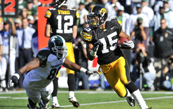 IOWA CITY, IA - OCTOBER 30: Wide reciver Derrell Johnson-Koulianos #15 of the University of Iowa Hawkeyes runs the ball past defensive end Colin Neely #89 of the Michigan State Spartans during the first half of play at Kinnick Stadium on October 30, 2010