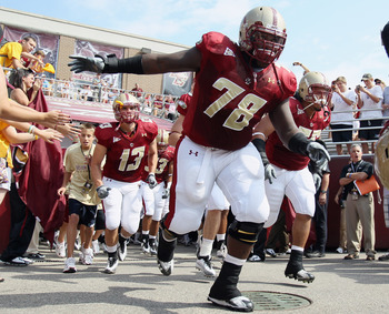 CHESTNUT HILL, MA - SEPTEMBER 25:  Thomas Claiborne #78 of the Boston College Eagles leads the team out on the field before the game against the Virginia Tech Hokies on September 25, 2010 at Alumni Stadium in Chestnut Hill, Massachusetts.  (Photo by Elsa/