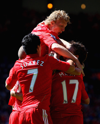 LIVERPOOL, ENGLAND - MAY 01: Dirk Kuyt,Luis Suarez celebrate with Team mate Maxi Rodriguez of Liverpool after he has scored the first goal during the Barclays Premier League match between Liverpool  and Newcastle United at Anfield on May 1, 2011 in Liverp