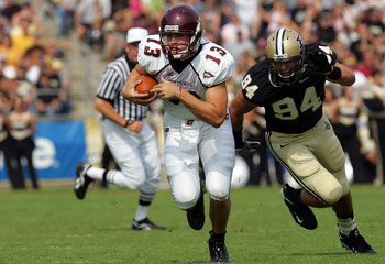 WEST LAFAYETTE, IN - SEPTEMBER 20:  Quarterback Dan LeFevour #13 of the Central Michigan Chippewas runs the ball past Ryan Kerrigan #94 of the Purdue Boilermakers at Ross-Ade Stadium on September 20, 2008 in West Lafayette, Indiana.  (Photo by Ronald Mart