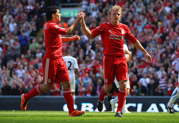 LIVERPOOL, ENGLAND - MAY 01:  Dirk Kuyt of Liverpool celebrates with team mate Luis Suarez after scoring the second goal from the penalty spot during the Barclays Premier League match between Liverpool  and Newcastle United at Anfield on May 1, 2011 in Li