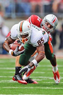 COLUMBUS, OH - SEPTEMBER 11:  Ross Homan #51 of the Ohio State Buckeyes tackles Leonard Hankerson #85 of the Miami Hurricanes at Ohio Stadium on September 11, 2010 in Columbus, Ohio.  (Photo by Jamie Sabau/Getty Images)