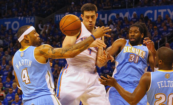 OKLAHOMA CITY, OK - APRIL 17: Nick Collison #4 of the Oklahoma City Thunder fights for a rebound against Kenyon Martin #4 and Nene #31 of the Denver Nuggets in Game One of the Western Conference Quarterfinals in the 2011 NBA Playoffs on April 17, 2011 at