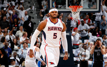 ATLANTA, GA - APRIL 28:  Josh Smith #5 of the Atlanta Hawks reacts after a dunk against the Orlando Magic during Game Six of the Eastern Conference Quarterfinals in the 2011 NBA Playoffs at Philips Arena on April 28, 2011 in Atlanta, Georgia.  NOTE TO USE