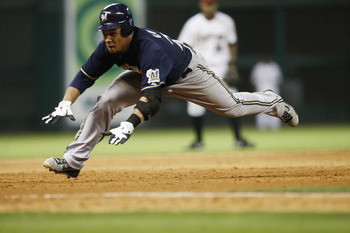 HOUSTON - APRIL 30:  Carlos Gomez #27 of the Milwaukee Brewers dives into third base against the Houston Astros at Minute Maid Park on April 30, 2011 in Houston, Texas. Gomez attempted to stretch a double into a triple was tagged out at third.  (Photo by