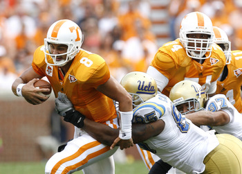 KNOXVILLE, TN - SEPTEMBER 12: David Carter #85 of the UCLA Bruins sacks Jonathan Crompton #8 of the Tennessee Volunteers on September 12, 2009 at Neyland Stadium in Knoxville, Tennessee. (Photo by Joe Murphy/Getty Images)