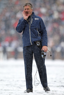 CINCINNATI, OH - DECEMBER 04:  Dave Wannstedt the Head Coach of the Pittsburgh Panthers gives instructions to his team during the Big East Conference game against the Cincinnati Bearcats at Nippert Stadium on December 4, 2010 in Cincinnati, Ohio.  (Photo