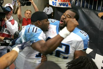 HOUSTON - DECEMBER 10:  Quarterback Vince Young #10 of the Tennessee Titans celebrates with defensive lineman Albert Haynesworth #92 after Young ran for the winning touchdown in overtime against the Houston Texans on December 10, 2006 at Reliant Stadium i