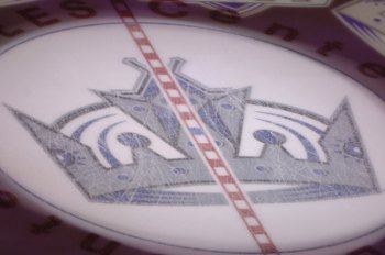 LOS ANGELES - NOVEMBER 9:  The Los Angeles Kings logo is shown on the ice before the game against the San Jose Sharks on November 9, 2006 at Staples Center in Los Angeles, California. The Sharks won 7-3. (Photo by Noah Graham/Getty Images)