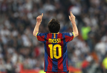 MADRID, SPAIN - APRIL 27:  Lionel Messi of Barcelona celebrates after scoring his second goal during the UEFA Champions League Semi Final first leg match between Real Madrid and Barcelona at Estadio Santiago Bernabeu on April 27, 2011 in Madrid, Spain.  (