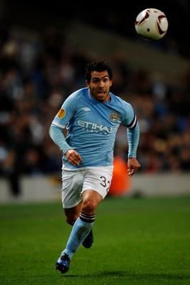 MANCHESTER, ENGLAND - MARCH 17:  Carlos Tevez of Manchester City runs with the ball during the UEFA Europa League round of 16 second leg match between Manchester City and Dynamo Kiev at City of Manchester Stadium on March 17, 2011 in Manchester, England.