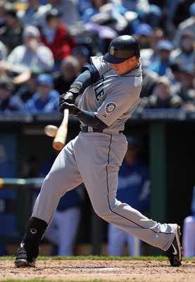 KANSAS CITY, MO - APRIL 16:  Justin Smoak #17 of the Seattle Mariners connects during the game against the Kansas City Royals on April 16, 2011 at Kauffman Stadium in Kansas City, Missouri.  (Photo by Jamie Squire/Getty Images)