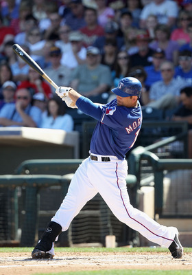 SURPRISE, AZ - MARCH 11:  Mitch Moreland #18 of the Texas Rangers bats against the Cincinnati Reds during the spring training game at Surprise Stadium on March 11, 2011 in Surprise, Arizona.  (Photo by Christian Petersen/Getty Images)
