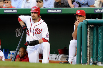 WASHINGTON, DC - APRIL 28:  Jayson Werth #28 and manager Jim Riggleman #5 of the Washington Nationals watch the game against the New York Mets at Nationals Park on April 28, 2011 in Washington, DC.  (Photo by Greg Fiume/Getty Images)