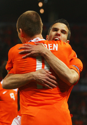 BERNE, SWITZERLAND - JUNE 13:  Robin van Persie of Netherlands celebrates with Arjen Robben after scoring his team's second goal during the UEFA EURO 2008 Group C match between Netherlands and France at Stade de Suisse Wankdorf on June 13, 2008 in Berne,