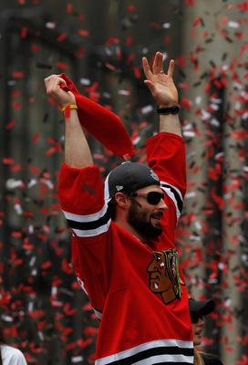 CHICAGO - JUNE 11: Troy Brouwer #22 waves to the corwd during the Chicago Blackhawks Stanley Cup victory parade and rally on June 11, 2010 in Chicago, Illinois. (Photo by Jonathan Daniel/Getty Images)