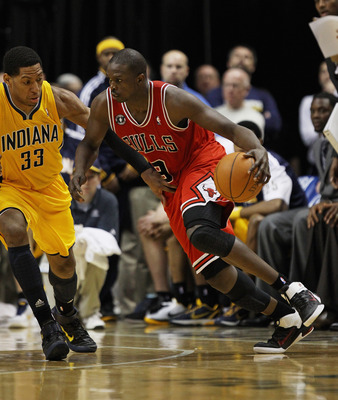 INDIANAPOLIS, IN - APRIL 23: Loul Deng #9 of the Chicago Bulls drives against Danny Granger #33 of the Indiana Pacers in Game Four of the Eastern Conference Quarterfinals in the 2011 NBA Playoffs at Conseco Fieldhouse on April 23, 2011 in Indianapolis, In