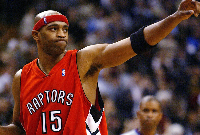 TORONTO - NOVEMBER 3:   Vince Carter #15 of the Toronto Raptors salutes the crowd after beating the Houston Rockets 95-88 during a game at the Air Canada Centre on November 3, 2003 in Toronto, Canada.  NOTE TO USER: User expressly acknowledges and agrees