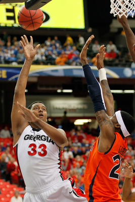 ATLANTA, GA - MARCH 10:  Trey Thompkins #33 of the Georgia Bulldogs shoots over Kenny Gabriel #22 of the Auburn Tigers during the the first round of the SEC Men's Basketball Tournament at the Georgia Dome on March 10, 2011 in Atlanta, Georgia.  (Photo by