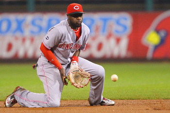 ST. LOUIS, MO - APRIL 22: Brandon Phillips #4 of the Cincinnati Reds fields a ground ball against the St. Louis Cardinals at Busch Stadium on April 22, 2011 in St. Louis, Missouri.  (Photo by Dilip Vishwanat/Getty Images)