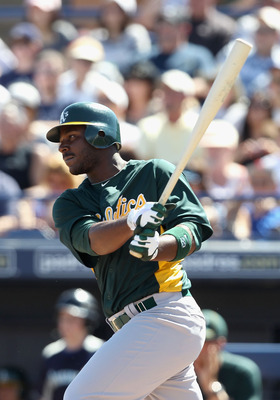 PEORIA, AZ - MARCH 12:  Chris Carter #22 of the Oakland Athletics bats against the Seattle Mariners during the spring training game at Peoria Stadium on March 12, 2011 in Peoria, Arizona.  (Photo by Christian Petersen/Getty Images)