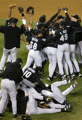 CHICAGO - OCTOBER 15:  Members of the Florida Marlins celebrate their 9-6 win over the Chicago Cubs during game seven of the National League Championship Series October 15, 2003 at Wrigley Field in Chicago, Illinois. (Photo by Elsa/Getty Images)