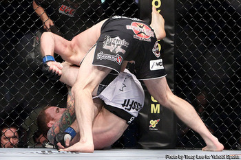 Jason MacDonald securing a triangle choke victory