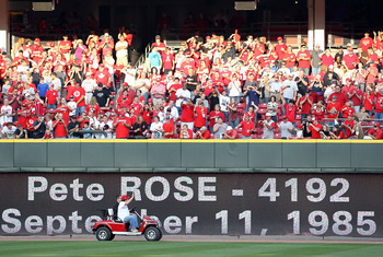 CINCINNATI - SEPTEMBER 11:  Pete Rose waves to the crowd following the ceremony celebrating the 25th anniversary of his breaking the career hit record of 4,192 on September 11, 2010 at Great American Ball Park in Cincinnati, Ohio. He was honored before th