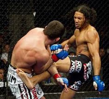Ben Henderson delivering a vicious body kick