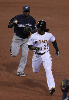 PITTSBURGH, PA - APRIL 14:  Andrew McCutchen #22 of the Pittsburgh Pirates gets caught in a run-down by Yuniesky Betancourt #3 of the Milwaukee Brewers at PNC Park on April 14, 2011 in Pittsburgh, Pennsylvania.  (Photo by Scott Halleran/Getty Images)