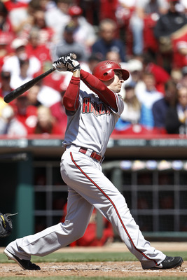 CINCINNATI, OH - APRIL 21: Kelly Johnson #2 of the Arizona Diamondbacks hits a solo home run in the fifth inning against the Cincinnati Reds at Great American Ball Park on April 21, 2011 in Cincinnati, Ohio. The Reds defeated the Diamondbacks 7-4. (Photo