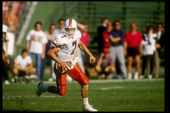 1 Dec 1990:  Quarterback Craig Erickson of the Miami Hurricanes runs down the field during a game against the San Diego State Aztecs at Jack Murphy Stadium in San Diego, California.  Miami won the game 30-28. Mandatory Credit: Stephen Dunn  /Allsport